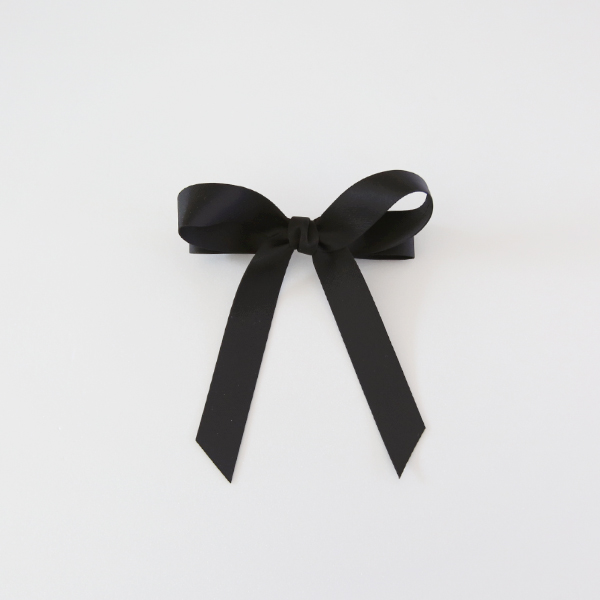 black ribbon-pin
